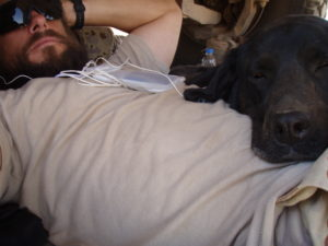 Sarbi and her handler, W.O. Simpson resting while on patrol in Afghanistan